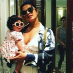 ADORABLE! Priyanka Chopra in a plunging neckline twinning in sunglasses with this little munchkin! See PICS!
