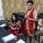 Radhe Maa sits in SHO's chair at Delhi police station as he stands with folded hands